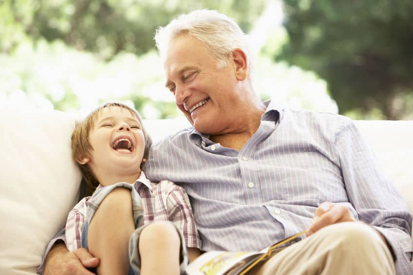 Grandfather laughing with grandson